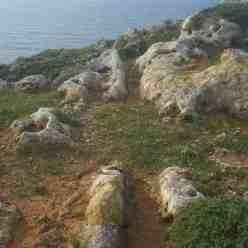 The mystery of the Cart Ruts leading of the top of a Cliff in Malta - Fomm Ir-Rih Bay